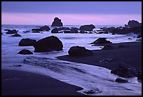 Stream, rocks, and ocean at dusk, False Klamath cove. Redwood National Park, California, USA. (color)