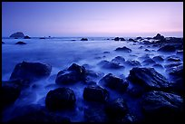 Boulders and ocean at dusk, False Klamath cove. Redwood National Park, California, USA.