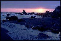 Stream reaches Pacific, False Klamath cove, sunset. Redwood National Park, California, USA.