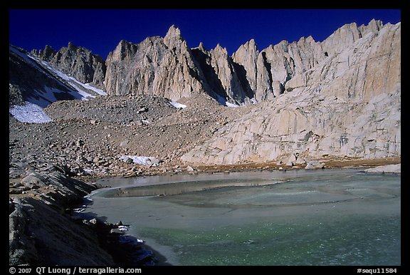 Frozen lake near Trail Camp and Mt Whitney chain. Sequoia National Park, California, USA.