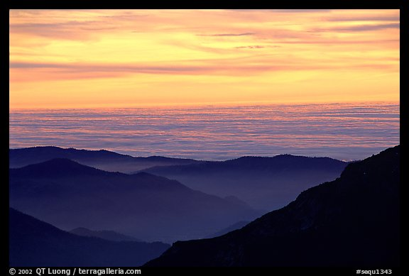 Receding lines of  foothills and sea of clouds at sunset. Sequoia National Park, California, USA.