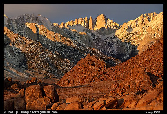 Volcanic boulders in Alabama hills and Mt Whitney, sunrise. Sequoia National Park, California, USA.