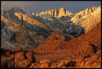 Volcanic boulders in Alabama hills and Mt Whitney, sunrise. Sequoia National Park, California, USA. (color)