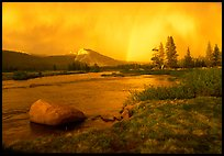 Tuolumne Meadows, Lembert Dome, and rainbow, storm clearing at sunset. Yosemite National Park, California, USA.