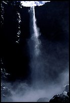 Bridalveil Falls as sun reaches upper shaft of water. Yosemite National Park, California, USA.