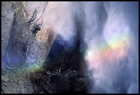 Rainbow, water, and rock at  base of Upper Yosemite Falls. Yosemite National Park, California, USA.