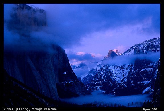 Valley view with fog, winter sunset. Yosemite National Park, California, USA.