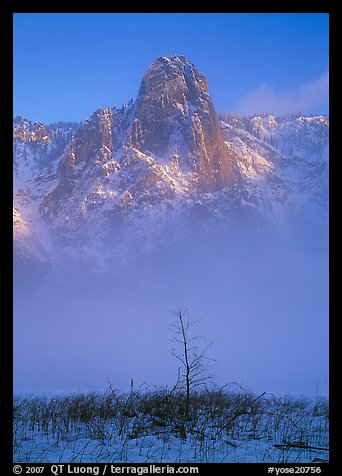Sentinel rock rising above fog on valley in winter. Yosemite National Park, California, USA.