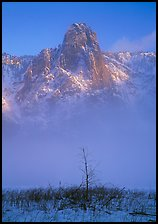 Sentinel rock rising above fog on valley in winter. Yosemite National Park, California, USA. (color)