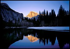 Half-Dome reflected in Merced River near Sentinel Bridge, sunset. Yosemite National Park, California, USA.