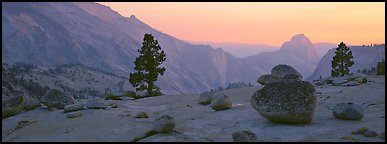 Erratic glacial boulders and Half-Dome at sunset. Yosemite National Park (Panoramic color)