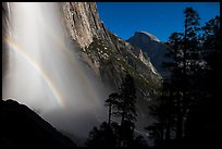Upper Yosemite Falls with double moonbow and Half-Dome. Yosemite National Park, California, USA.