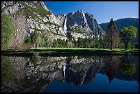 Yosemite Falls and meadow reflected in a seasonal pond. Yosemite National Park, California, USA. (color)