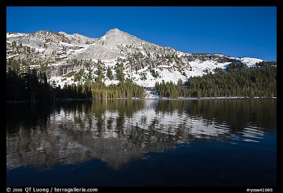 Tenaya Lake, with partly snow-covered peak reflected. Yosemite National Park, California, USA.