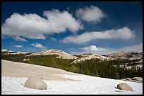 Snow on slab, boulders, and distant domes, Tuolumne Meadows. Yosemite National Park, California, USA.