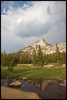 Meadow, Cathedral Peak, and clouds. Yosemite National Park, California, USA.