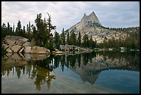 Upper Cathedral Lake and Cathedral Peak at dusk. Yosemite National Park, California, USA.