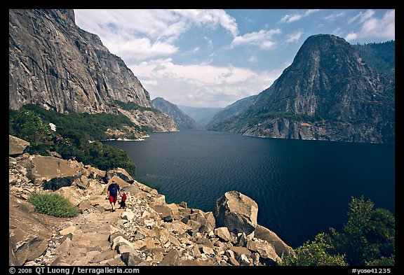 Father hiking with boy next to Hetch Hetchy reservoir. Yosemite National Park (color)