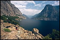 Father hiking with boy next to Hetch Hetchy reservoir. Yosemite National Park, California, USA. (color)