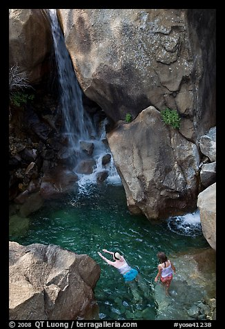 Swimmers in a pool at the base of Wapama falls, Hetch Hetchy. Yosemite National Park (color)