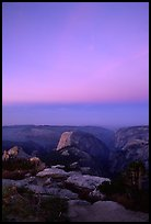 Half-Dome and Yosemite Valley under  pink hues of dawn sky. Yosemite National Park, California, USA.