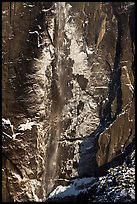 Upper Yosemite Falls and icy rock wall. Yosemite National Park, California, USA.