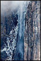 Ribbon Falls and snowy cliff. Yosemite National Park, California, USA.
