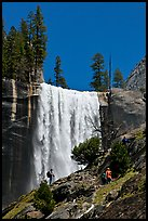 Hikers standing on Mist Trail below Vernal Fall. Yosemite National Park, California, USA.