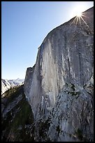 Sunburst at the top of Half-Dome face. Yosemite National Park, California, USA. (color)