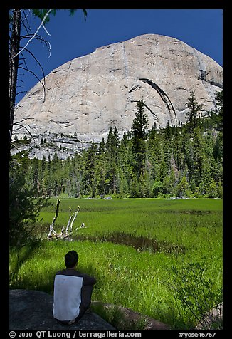 Hiker sitting at Lost Lake on west side Half-Dome. Yosemite National Park (color)