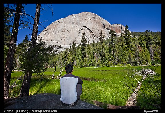 Hiker looking at backside of Half-Dome from Lost Lake. Yosemite National Park (color)