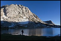 Hiker standing on shore of Fletcher Lake. Yosemite National Park, California, USA.