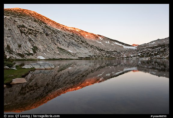 Last light on Fletcher Peak above Vogelsang Lake. Yosemite National Park, California, USA.