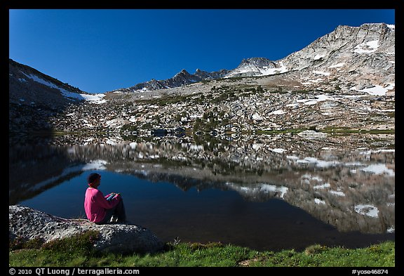 Hiker contemplating Vogelsang Lake and Peak. Yosemite National Park, California, USA.