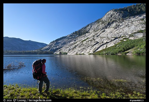 Backpacker on shores of Merced Lake, morning. Yosemite National Park, California, USA.