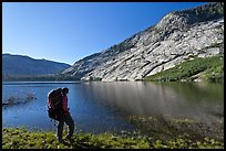 Backpacker on shores of Merced Lake, morning. Yosemite National Park, California, USA. (color)