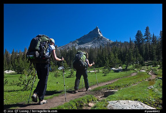 Women backpacking on John Muir Trail below Tressider Peak. Yosemite National Park (color)