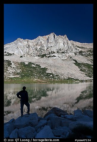 Hiker standing  on Roosevelt lakeshore. Yosemite National Park, California, USA.