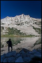 Hiker standing  on Roosevelt lakeshore. Yosemite National Park ( color)