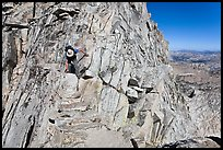 Hiker on summit block of Mount Conness. Yosemite National Park ( color)