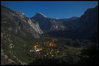 Yosemite Village lights and Half-Dome by moonlight. Yosemite National Park, California, USA. (color)