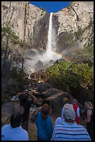 Visitors standing below Bridalvail Fall. Yosemite National Park, California, USA. (color)