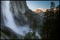 Upper Yosemite Falls and Half-Dome at sunset. Yosemite National Park, California, USA. (color)