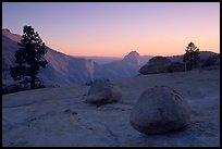 Glacial erratics, pines, Clouds rest and Half-Dome from Olmstedt Point, sunset. Yosemite National Park, California, USA.