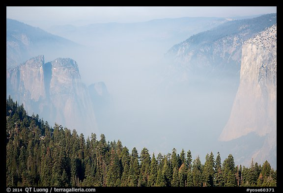 Smoky Yosemite Valley framed by Cathedral Rocks and El Capitan. Yosemite National Park (color)