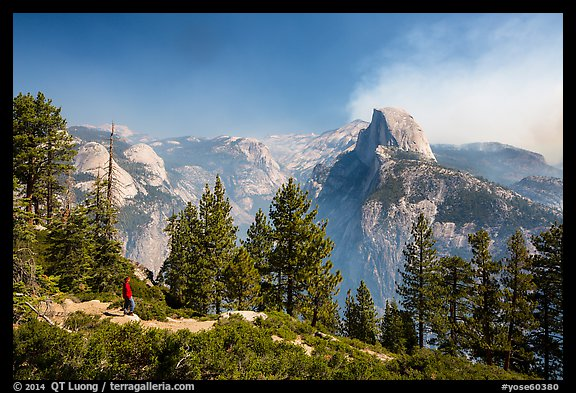 Visitor looking, Glacier Point. Yosemite National Park (color)