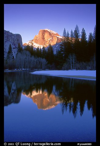 Half-Dome reflected in Merced River, winter sunset. Yosemite National Park, California, USA.