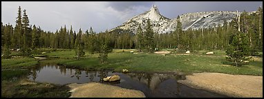 Stream and Cathedral Peak in storm light. Yosemite National Park (Panoramic color)