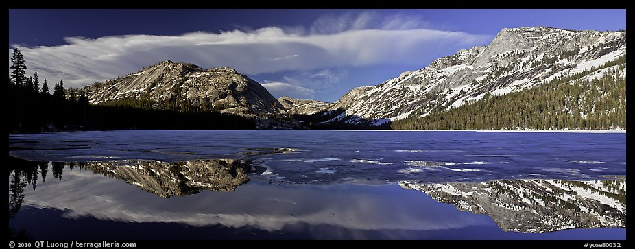 Mountains reflected in partly iced Tenaya Lake. Yosemite National Park (color)
