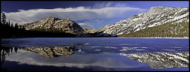 Mountains reflected in partly iced Tenaya Lake. Yosemite National Park, California, USA. (color)
